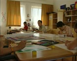 Stock Video Footage of Art workshop for mentally handicapped artists with teacher