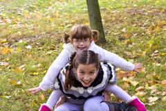 Two girls playing Stock Photos