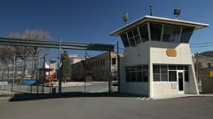 975  generic prison gates with guard tower four - stock footage