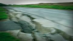 Earthquake rips road apart, shaking the Earth with violent action. - stock footage