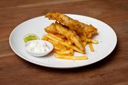 Shrimp tempura dish with white sauce and fried potatoes Stock Photos