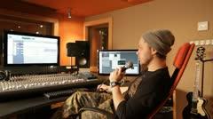 Producer explaining something in recording studio - tracking shot Stock Footage