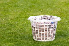 laundry basket on grass - stock photo