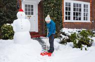 Person shoveling snow Stock Photos