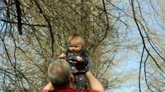 Grandfather playing with infant granddaughter Stock Footage
