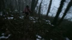 Escaping in the dark forest - stock footage