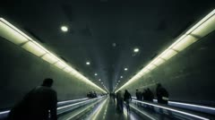 Persons moving in underground corridor. Slow motion Stock Footage