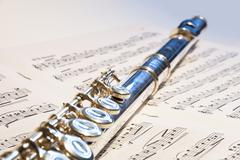 flute instrument on the notes - stock photo
