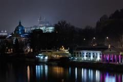 Strakas academy and prague castle at night Stock Photos