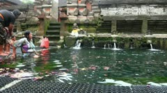 People taking bath in holy springs in Tampaksiring Bali indonesia Stock Footage