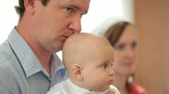 Father with baby on Baptism Stock Footage