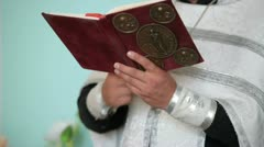 Priest with Bible in hands Stock Footage