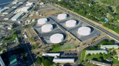 Aerial view of oil storage tanks, Hawaii Stock Footage