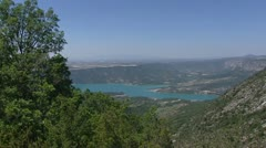 Lake of Sainte-Croix in Verdon, France + pan mountain slope with mountain pass Stock Footage