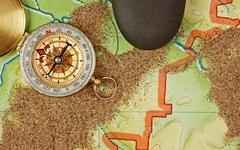 Compass on the map with sand Stock Photos