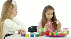 Two little girls painted Easter eggs Stock Footage