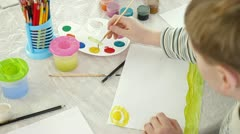 child drawing in watercolor - stock footage