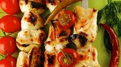 Fresh roast chicken shish kebab on green platter Stock Footage