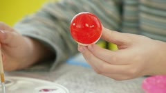 Kid Painting Easter eggs Stock Footage