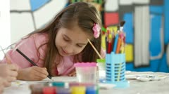 Little Girl Painting - stock footage