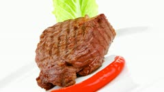 Barbecued meat : beef ( lamb ) garnished with green lettuce and red pepper Stock Footage