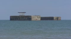 Caisssons Mulberry Harbour in sea, zoom out Gold Beach Stock Footage