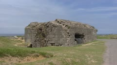 Remains of German casemate Atlantic Wall + pan ruins at Pointe du Hoc Stock Footage