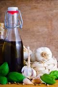 Olive oil, garlic and basil Stock Photos