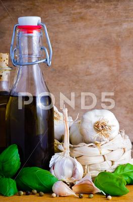 Stock photo of olive oil, garlic and basil