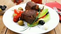 Meat savory : beef fillet mignon grilled and garnished with baked apples Stock Footage