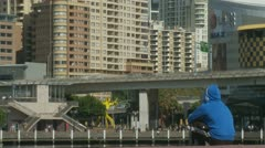 Fast traffic, man watching, Darling Harbour (speeded) Stock Footage