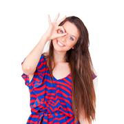 young beautiful women happy making hole gestures on face - stock photo