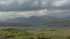 Ballinaboy, Connemara peat bog landscape + mountain range. Stock Footage