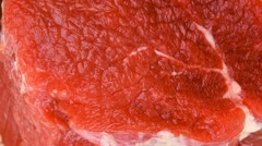 Raw red meat: two fresh beef fillet chops with small thyme twig on wooden plate Stock Footage