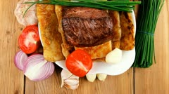 Roast meat : beef ( lamb ) steak garnished with onion tomatoes salad and chives Stock Footage