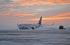 Ukraine internaional airlines (uia) airplane under sunrise in winter. Stock Photos