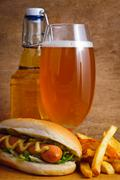 Beer, hotdog and fries Stock Photos