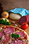 homemade pizza and ingredients - stock photo