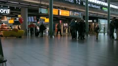 People walking at Amsterdam Schiphol airport Stock Footage