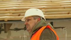 Angry construction foreman talking on the phone Stock Footage
