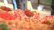 Stock Video Footage of 681. merchant arranging candies