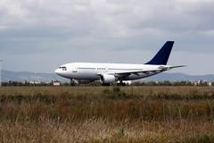 arriving plane - stock photo