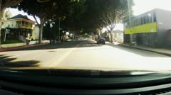 POV Driving Street With Canopy Of Trees, Businesses - stock footage