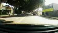 Stock Video Footage of POV Driving Street With Canopy Of Trees, Businesses