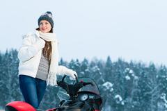Stock Photo of woman and snowmobile