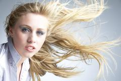 Young Woman With Hair Blowing Behind - stock photo