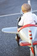 Baby Girl Riding In Toy Aeroplane - stock photo