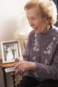 Senior Woman Watching TV At Home - stock photo