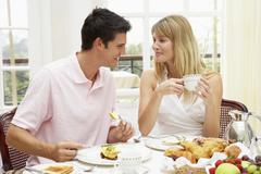 Young Couple Enjoying Hotel Breakfast - stock photo