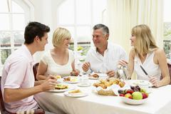 Family Group Enjoying Hotel Breakfast - stock photo